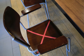 A social distancing mark is seen on a chair at KFC fast food restaurant, following the novel coronavirus disease (COVID-19) outbreak, in Hong Kong