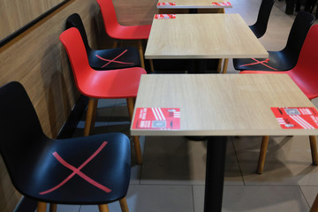 Social distancing marks are seen on chairs at KFC fast food restaurant, following the novel coronavirus disease (COVID-19) outbreak, in Hong Kong