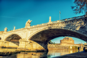 Fotobehang - Embankment of the river Tiber at the bridge in the early morning. Rome.  Europe