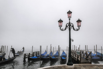 Venice with gondolas against foggy day in Italy