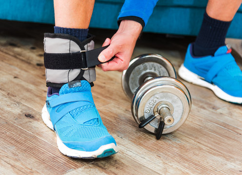 Man with ankle weight during home workout