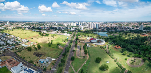Aerial view of Campo Grande MS, Brazil - Highs of Afonso Pena avenue. Aerial view of a growing city with some buildings and a huge green area. Green city.