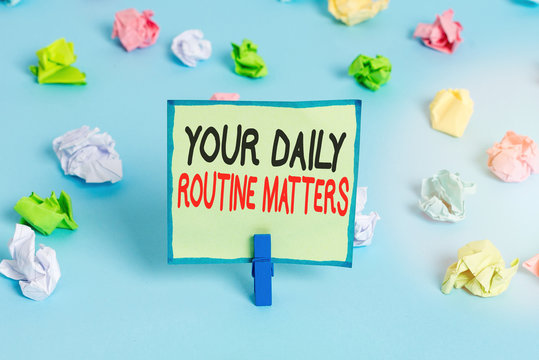 Conceptual hand writing showing Your Daily Routine Matters. Concept meaning practice of regularly doing things in fixed order Colored crumpled papers empty reminder blue floor clothespin
