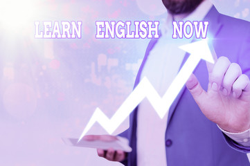 Text sign showing Learn English Now. Business photo showcasing gain or acquire knowledge and skill...
