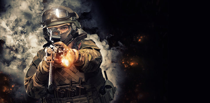 Portrait of a special forces soldier who is aiming at a collimator sight of a machine gun. The concept of special military units. Computer games.