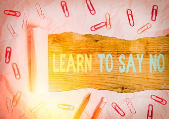Writing note showing Learn To Say No. Business concept for decline or refuse few things before you destroy yourself
