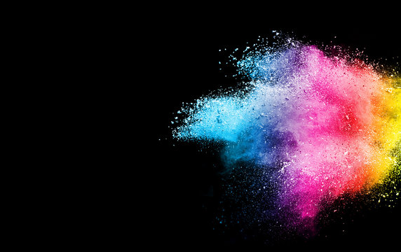 Freeze motion of colorful color powder exploding on black background.  Paint Holi.Indian festival Holi