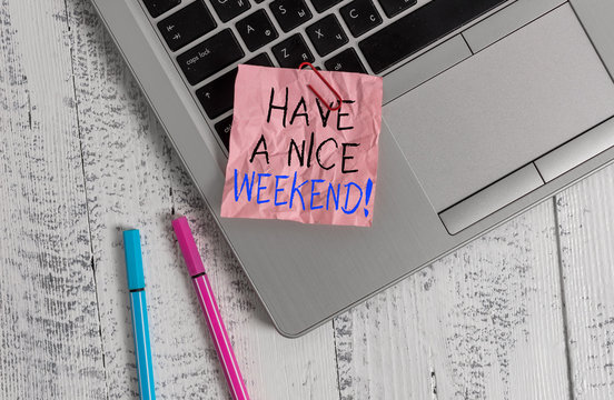 Conceptual hand writing showing Have A Nice Weekend. Concept meaning wishing someone that something nice happen holiday Metallic laptop crushed colored paper note pens lying wooden table