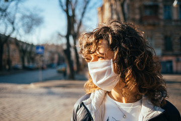 Young woman in protective face mask looking away Fotomurales