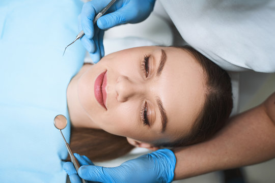 Relaxed woman is visiting dentist stock photo