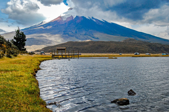 View of the Limpiopungo lagoon with the Cotopaxi volcano in the background  on a cloudy and overcast afternoon - Ecuador