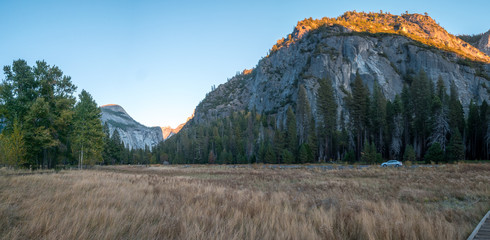 Wide Angle Panorama of the Various Peaks Touched by the Last Sunshine Rays at Sunset in Yosemite...