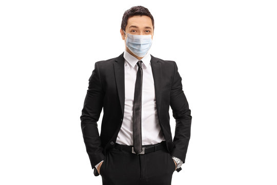 Young businessman wearing a protective medical face mask