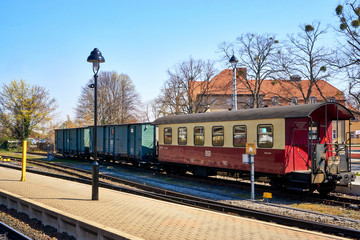 Railroad cars of the narrow-gauge railway at a train station in Wernigerode. Brockenbahn in the Harz Mountains. Saxony-Anhalt, Germany