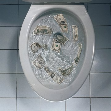 Overhead shot of money being flushed in the toilet - great for background