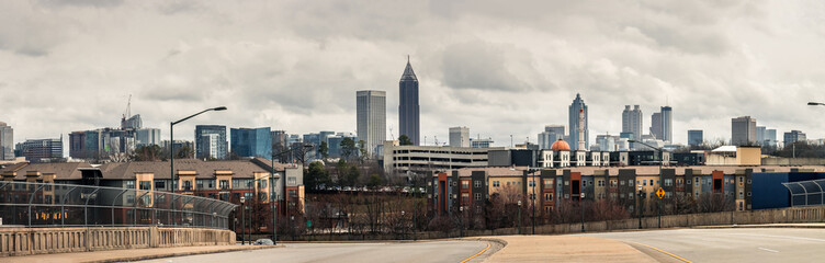 Wall Mural - Downtown Atlanta Skyline showing several prominent buildings, apartments and hotels under a cloudy sky.