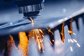 Laser CNC cutting of metal with light spark Industrial manufacture technology