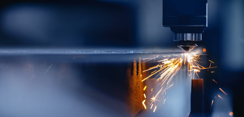 Foto auf AluDibond Metall Blue color Laser CNC cut of metal with light spark, technology modern industrial