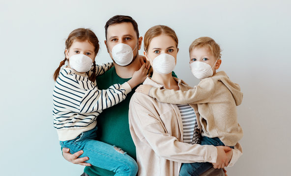 Family in medical masks during disease outbreak.
