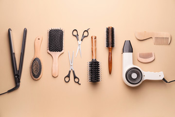 Set of hairdresser's accessories on color background