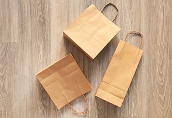 Paper shopping bags on floor, top view