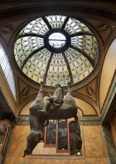 PRAGUE. CZECH REPUBLIC. 12 AUGUST 2019 : Sculpture Horse (Kun) by David Cerny at Lucerna Arcade in Prague. Czech Republic