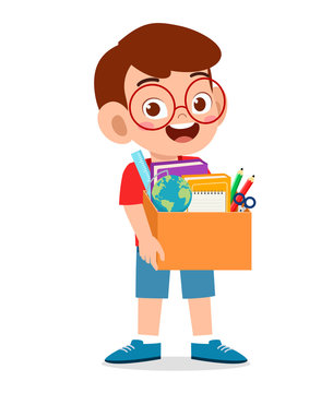 happy cute little kid boy carry box of school supplies