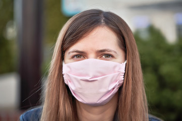 Young woman with hand made face nose mouth mask portrait, can be used during coronavirus covid19...