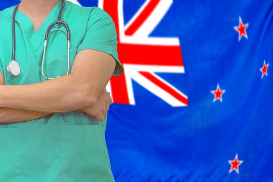Male surgeon or doctor with stethoscope on the background of the New Zealand flag. Health care and medical concept. Surgery concept in New Zealand.