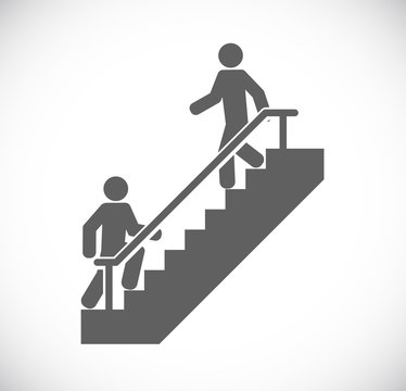 two persons walk stairs
