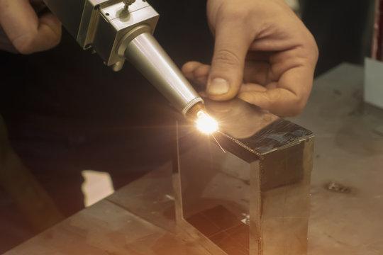 Fiber laser welding. Manual laser welding of metal
