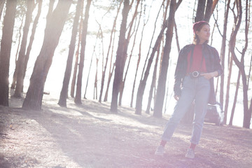 beautiful stylish girl in the forest