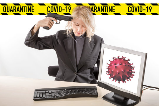 Businesswoman in smart working with her gun aimed at her own head after learning she was positive at Covid-19. Concept of losing job, company bankruptcy, coronavirus stress, quarantine depression.