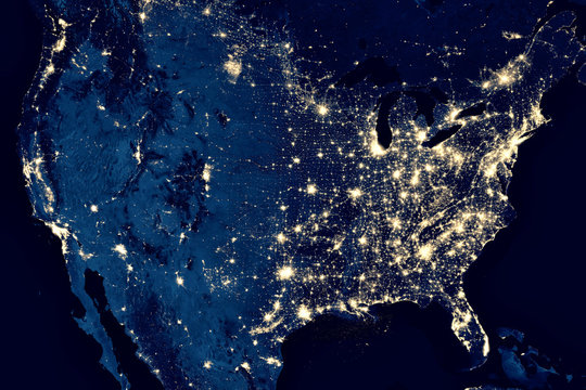 Earth at night, view of city lights in United States from space. USA on world map on global satellite photo. US terrain on dark planet.