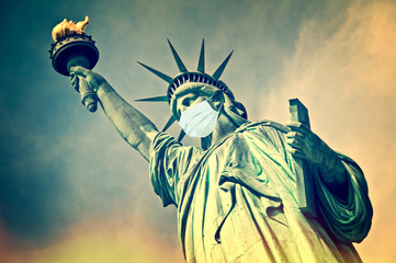 Statue of Liberty wearing a medical face mask. New coronavirus, covid-19 in New York and USA epidemic crisis concept Fotomurales