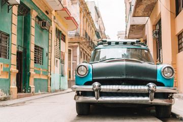 Poster Havana View of yellow classic vintage car in Old Havana, Cuba