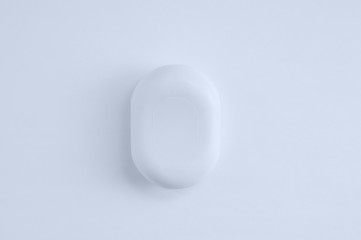 Closeup a bar of soap on white background. View from above.
