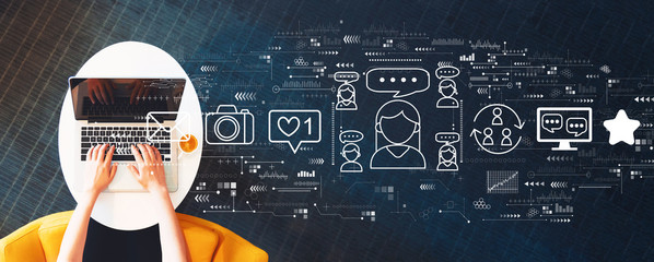 Fototapeta Social media theme with person using a laptop on a white table obraz