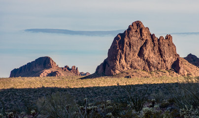 View of Sonoran Desert landscape in western Arizona in Kofa Wildlife Refuge. Rocky outcroppings rise from desert floor.