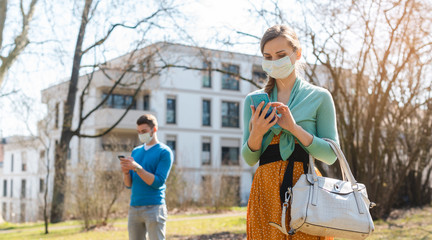People during covid-19 crisis looking for news on their phones