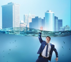 Drowning businessman in insolvency and bankruptcy concept