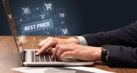 Businessman working on laptop with BEST PRICE inscription, online shopping concept