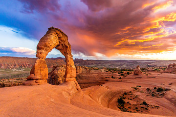 Fotobehang Koraal Sunset over Delicate Arch - Desert Arches National Park Landscape Picture