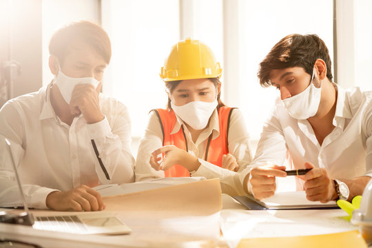 engineer project meeting of Businesswoman Sweating At Work With Broken Conditioner all of people wear protecting mask from covid-19 virus spread pandemic summer season office background
