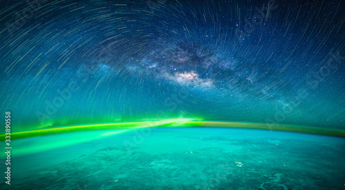 Wall mural Landscape with Milky way galaxy. Earth and Aurora view from space with Milky way galaxy. (Elements of this image furnished by NASA)