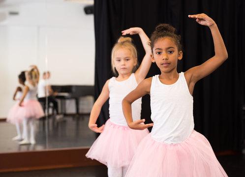 Two little girls rehearsing in dance school
