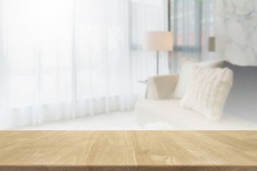 Empty wood table top and blurred living room in home interior with curtain window background. - can used for display or montage your products. Wall mural