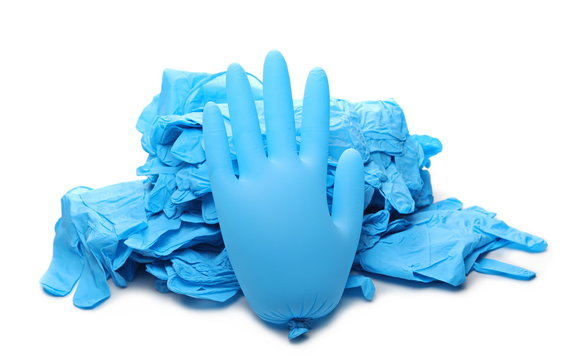 Pile latex surgical gloves isolated on white background