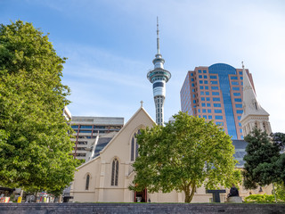 Sky Tower with St Patrick's Cathedral in Auckland city of New Zealand.