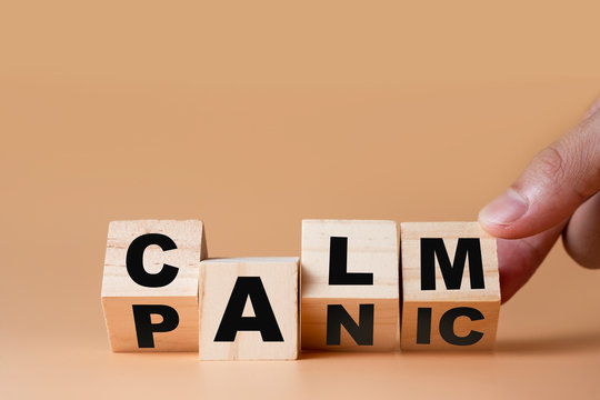 "Hand flipping wooden cubes for change wording"" Panic ""  to "" Calm"".  Mindset is important for human development."